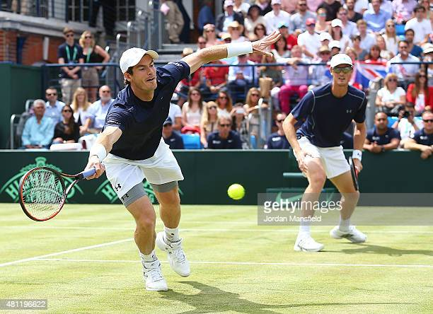 Jamie Murray and Andy Murray of Great Britain in action in their match against Nicolas Mahut and JoWilfried Tsonga of France during Day Two of the...