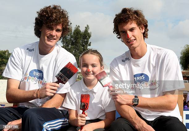 Jamie Murray and brother Andy Murray Britains no 1 tennis player with Rachel Wood a pupil form Dorchester Primary School during the RBS Supergrounds...