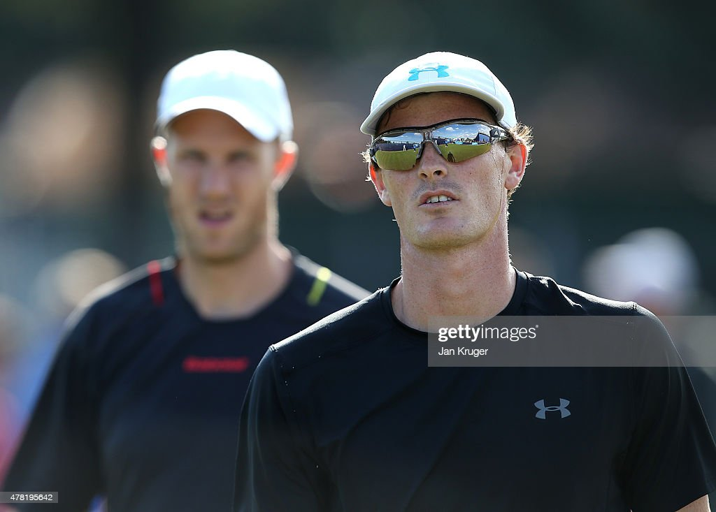 Jamie Murray and Dominic Inglot of Great Britain look on in their doubles match against Thomaz Bellucci and Marcelo Melo of Brazil on day three of...