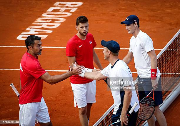 Jamie Murray and Dominic Inglot of Great Britain shake hands with the Nenad Zimonjic and Filip Krajinovic after day two of the Davis Cup Quarter...