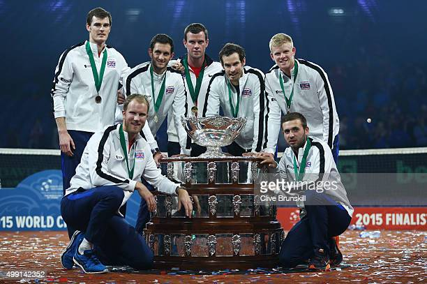 Jamie Murray Dom Inglot James Ward Leon Smith Andy Murray Kyle Edmund and Dan Evans of Great Britain pose with the Davis Cup following victory on day...