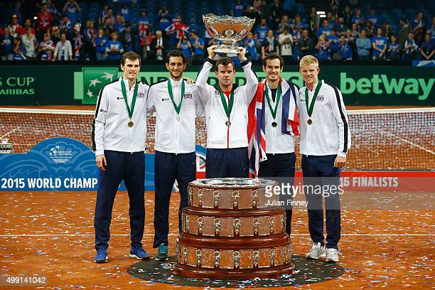 Jamie Murray James Ward Leon Smith Andy Murray and Kyle Edmund of Great Britain celebrate with the Davis Cup following victory on day three of the...