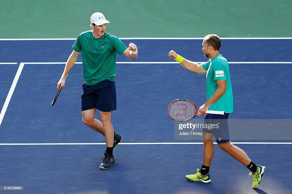<a gi-track='captionPersonalityLinkClicked' href=/galleries/search?phrase=Jamie+Murray+-+Tennis+Player&family=editorial&specificpeople=4393751 ng-click='$event.stopPropagation()'>Jamie Murray</a> of Great Britain and <a gi-track='captionPersonalityLinkClicked' href=/galleries/search?phrase=Bruno+Soares+-+Tennis+Player&family=editorial&specificpeople=11650044 ng-click='$event.stopPropagation()'>Bruno Soares</a> of Brazil celebrate winning a point against Feliciano Lopez and Marc Lopez of Spain in the doubles during day eleven of the BNP Paribas Open at Indian Wells Tennis Garden on March 17, 2016 in Indian Wells, California.