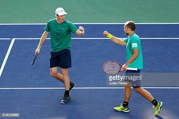 Jamie Murray of Great Britain and Bruno Soares of Brazil celebrate winning a point against Feliciano Lopez and Marc Lopez of Spain in the doubles...