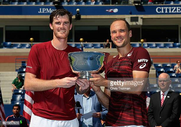 Jamie Murray of Great Britain and Bruno Soares of Brazil celebrate with the trophy after defeating Pablo Carreno Busta and Guillermo GarciaLopez of...