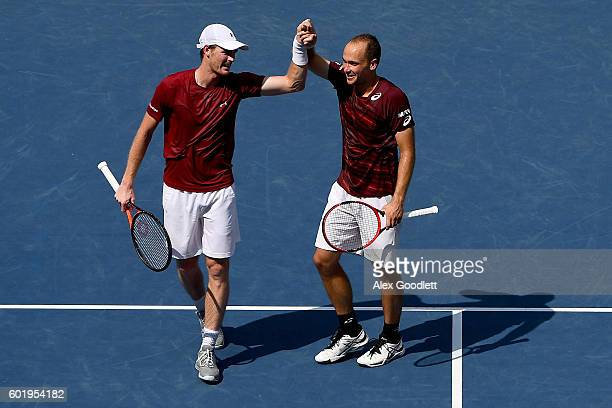 Jamie Murray of Great Britain and Bruno Soares of Brazil celebrate after defeating Pablo Carreno Busta and Guillermo GarciaLopez of Spain with a...