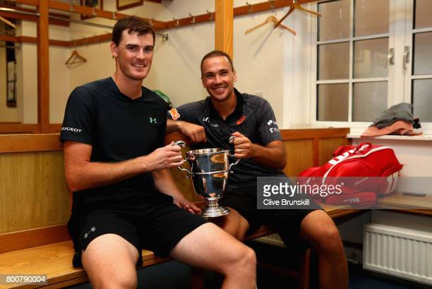 Jamie Murray of Great Britain and Bruno Soares of Brazil celebrate victory in the locker room following the mens doubles final against Julien...