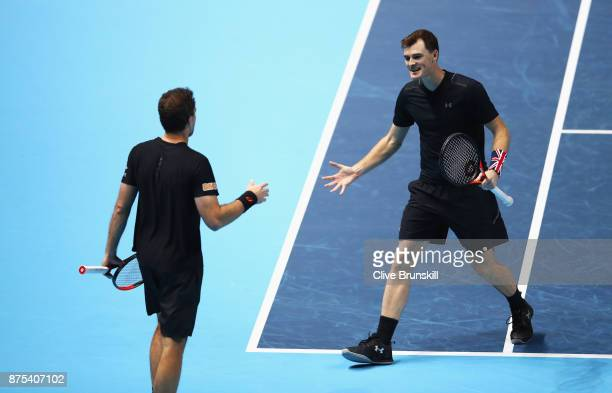 Jamie Murray of Great Britain and Bruno Soares of Brazil celebrate victory in the Doubles match against Lukasz Kubot of Poland and Marcelo Melo of...
