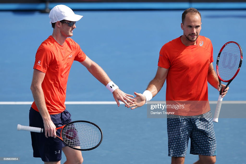 <a gi-track='captionPersonalityLinkClicked' href=/galleries/search?phrase=Jamie+Murray+-+Tennis+Player&family=editorial&specificpeople=4393751 ng-click='$event.stopPropagation()'>Jamie Murray</a> of Great Britain and <a gi-track='captionPersonalityLinkClicked' href=/galleries/search?phrase=Bruno+Soares+-+Tennis+Player&family=editorial&specificpeople=11650044 ng-click='$event.stopPropagation()'>Bruno Soares</a> of Brazil compete in their fourth round match against Raven Klaasen of South Africa and Rajeev Ram of the United States during day nine of the 2016 Australian Open at Melbourne Park on January 26, 2016 in Melbourne, Australia.
