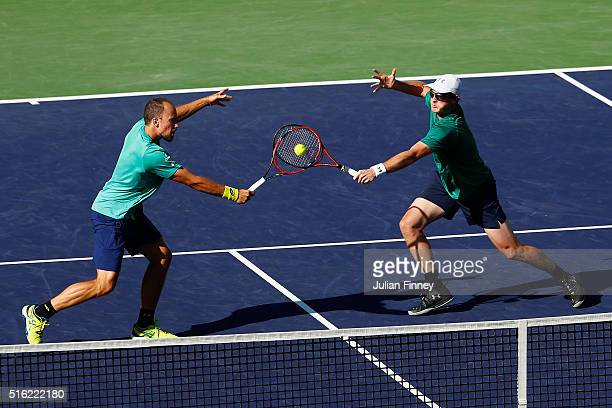 Jamie Murray of Great Britain and Bruno Soares of Brazil in action against Feliciano Lopez and Marc Lopez of Spain in the doubles during day eleven...