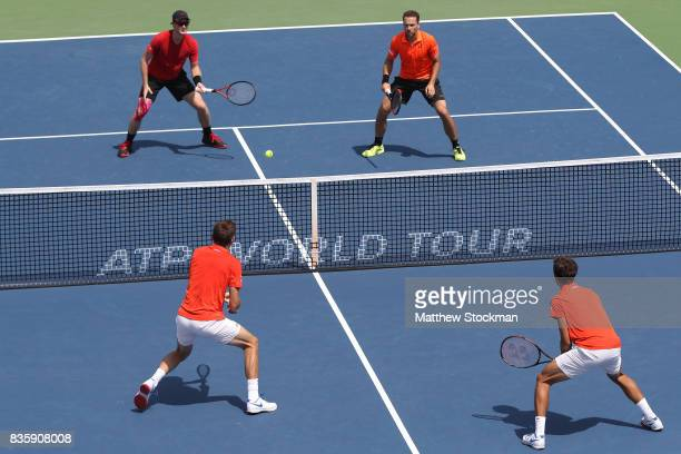 Jamie Murray of Great Britain and Bruno Soares of Brazil play Nicolas Mahut and PierreHughes Herbert of France in the men's double final during day 9...