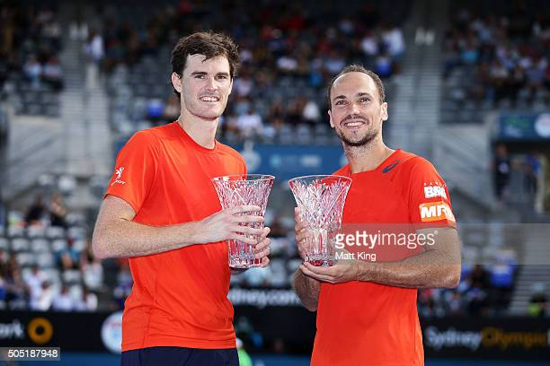 Jamie Murray of Great Britain and Bruno Soares of Brazil pose with the winners trophy after the Mens Doubles Final against Rohan Bopanna of India and...
