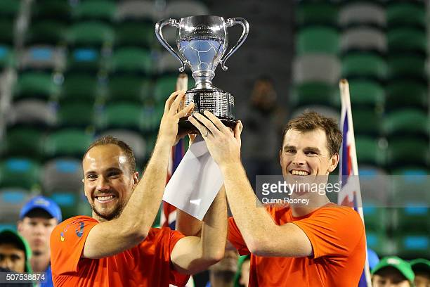Jamie Murray of Great Britain and Bruno Soares of Brazil pose with the trophy after winning their Men's Doubles Final match against Daniel Nestor of...