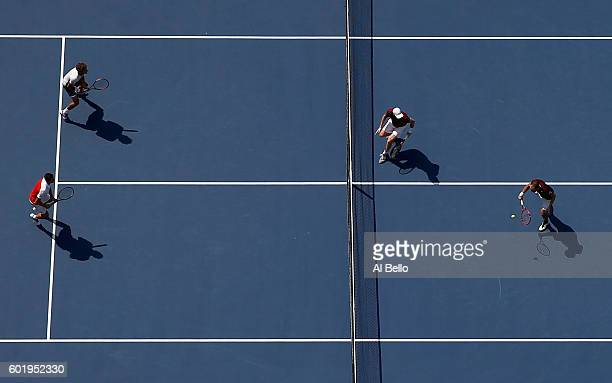 Jamie Murray of Great Britain and Bruno Soares of Brazil return a shot to Pablo Carreno Busta and Guillermo GarciaLopez of Spain during their Men's...