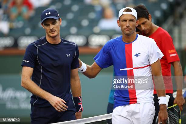 Jamie Murray of Great Britain and Bruno Soares of Brazil shake hands at the net after their three set defeat by Lukasz Kubot of Poland and Marcelo...