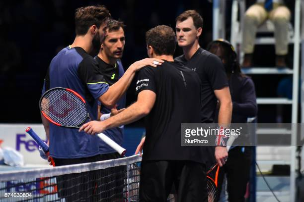 Jamie Murray of Great Britain and Bruno Soares of Brazil shake hands after victory during their Doubles match against Ivan Dodig of Croatia and...