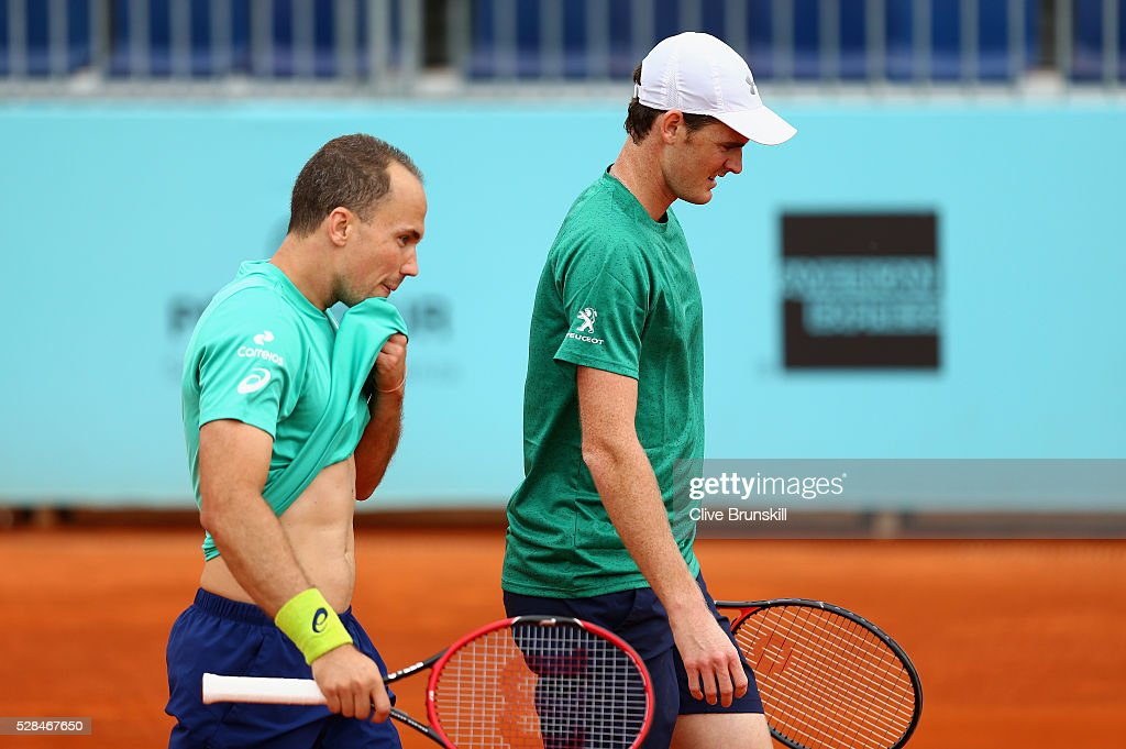 <a gi-track='captionPersonalityLinkClicked' href=/galleries/search?phrase=Jamie+Murray+-+Tennis+Player&family=editorial&specificpeople=4393751 ng-click='$event.stopPropagation()'>Jamie Murray</a> of Great Britain and <a gi-track='captionPersonalityLinkClicked' href=/galleries/search?phrase=Bruno+Soares+-+Tennis+Player&family=editorial&specificpeople=11650044 ng-click='$event.stopPropagation()'>Bruno Soares</a> of Brazil show their dejection against Henri Kontinen of Finland and John Peers of Australia in their doubles match during day six of the Mutua Madrid Open tennis tournament at the Caja Magica on May 05, 2016 in Madrid,Spain
