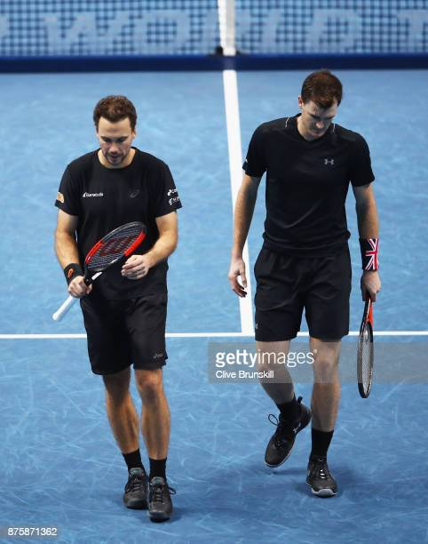 Jamie Murray of Great Britain and Bruno Soares of Brazil show their dejection during their straight sets defeat by Henri Kontinen of Finland and John...