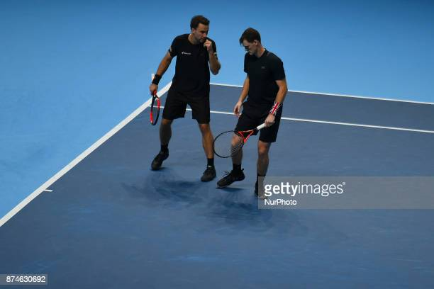 Jamie Murray of Great Britain and Bruno Soares of Brazil speak during the doubles match against Ivan Dodig of Croatia and Marcel Granollers of Spain...