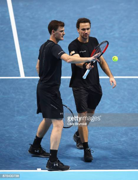 Jamie Murray of Great Britain and Bruno Soares of Brazil talk in the Doubles match against Lukasz Kubot of Poland and Marcelo Melo of Brazil during...