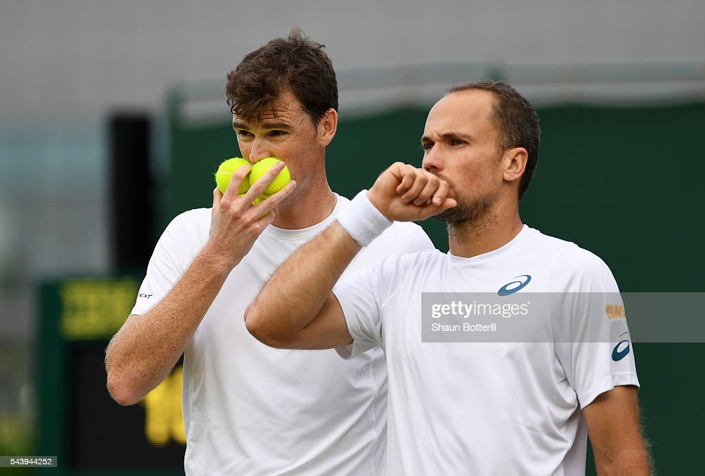 <a gi-track='captionPersonalityLinkClicked' href=/galleries/search?phrase=Jamie+Murray+-+Tennis+Player&family=editorial&specificpeople=4393751 ng-click='$event.stopPropagation()'>Jamie Murray</a> of Great Britain and <a gi-track='captionPersonalityLinkClicked' href=/galleries/search?phrase=Bruno+Soares+-+Tennis+Player&family=editorial&specificpeople=11650044 ng-click='$event.stopPropagation()'>Bruno Soares</a> of Brazil talk tactics during the Men's doubles first round match against Jonathan Erlich of Israel and Colin Fleming of Great Britain on day four of the Wimbledon Lawn Tennis Championships at the All England Lawn Tennis and Croquet Club on June 30, 2016 in London, England.
