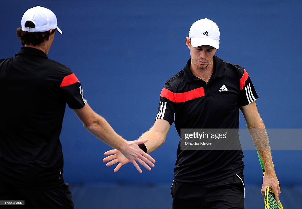 Jamie Murray (L) of Great Britain and John Peers (R) of Australia celebrate during their first round men's Doubles match against David Marrero and Fernando Verdasco of Spain on Day Four of the 2013 US Open at USTA Billie Jean King National Tennis Center on August 29, 2013 in the Flushing neighborhood of the Queens borough of New York City.
