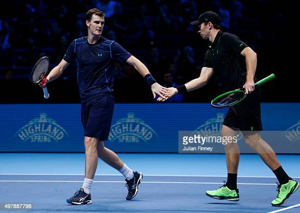 Jamie Murray of Great Britain and John Peers of Australia claps hands in their men's doubles match against Mike Bryan of the USA and Bob Bryan of the...