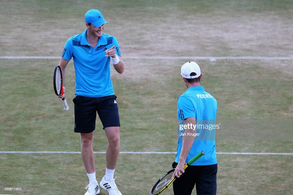 Jamie Murray (blue cap) of Great Britain and <a gi-track='captionPersonalityLinkClicked' href=/galleries/search?phrase=John+Peers&family=editorial&specificpeople=9486129 ng-click='$event.stopPropagation()'>John Peers</a> (white cap) of Australia defeat Julien Benneteau of France and Edouard Roger-Vasselin of France during their Men's Doubles semi-final match on day six of the Aegon Championships at Queens Club on June 14, 2014 in London, England.