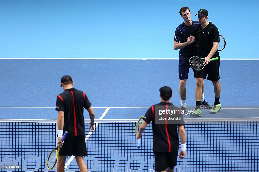 Jamie Murray of Great Britain and John Peers of Australia (top) look dejected after losing to Mike Bryan of the USA and Bob Bryan of the USA (bottom) in their men's doubles match on day five of the Barclays ATP World Tour Finals at the O2 Arena on November 19, 2015 in London, England.