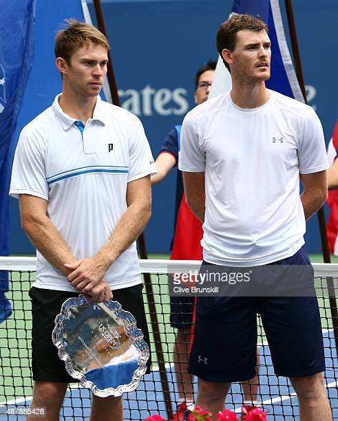 Jamie Murray of Great Britain and John Peers of Australia look on as PierreHugues Herbert and Nicolas Mahut of France celebrate defeating them during...