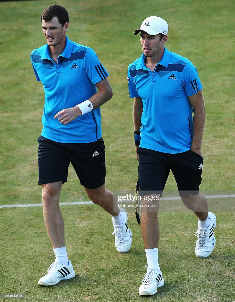 Jamie Murray of Great Britain and John Peers (white cap) of Australia play Julien Benneteau of France and Edouard Roger-Vasselin of France during their Men's Doubles semi-final match on day six of the Aegon Championships at Queens Club on June 14, 2014 in London, England.