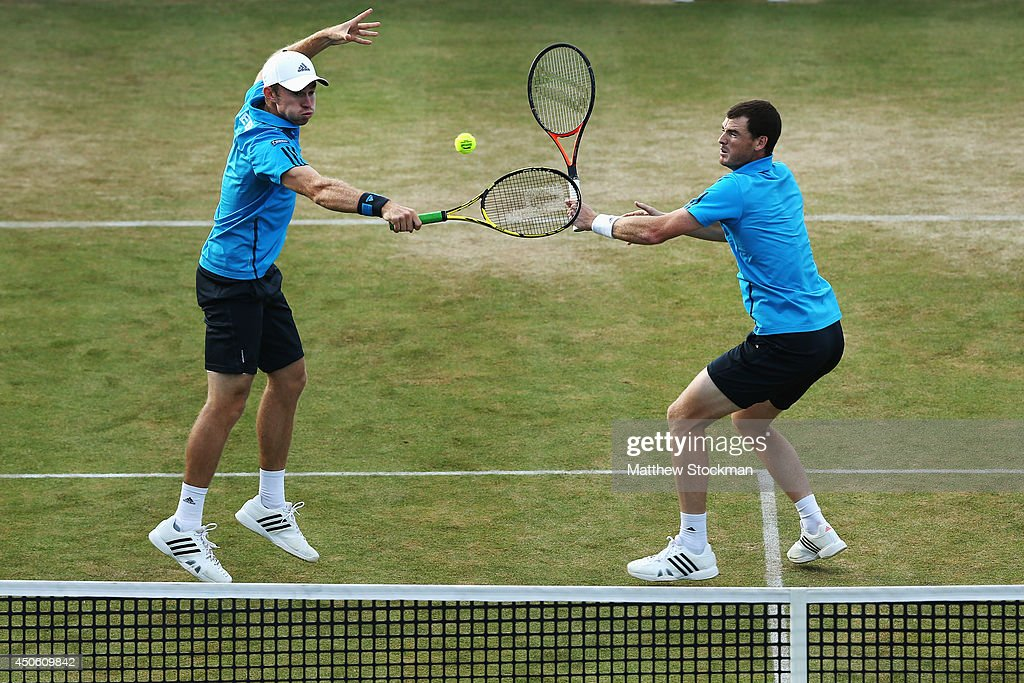 Jamie Murray of Great Britain and <a gi-track='captionPersonalityLinkClicked' href=/galleries/search?phrase=John+Peers&family=editorial&specificpeople=9486129 ng-click='$event.stopPropagation()'>John Peers</a> (white cap) of Australia play Julien Benneteau of France and Edouard Roger-Vasselin of France during their Men's Doubles semi-final match on day six of the Aegon Championships at Queens Club on June 14, 2014 in London, England.