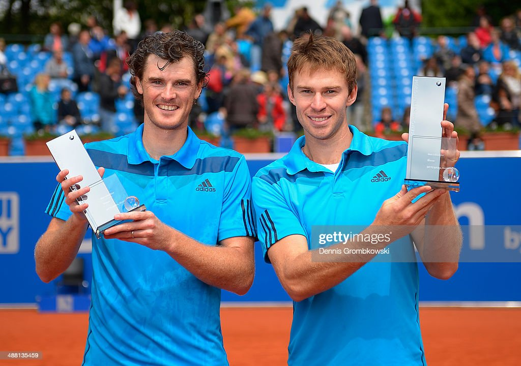 Jamie Murray of Great Britain and John Peers of Australia pose with their trophies after winning the Mens Doubles Final against Ross Hutchins and...