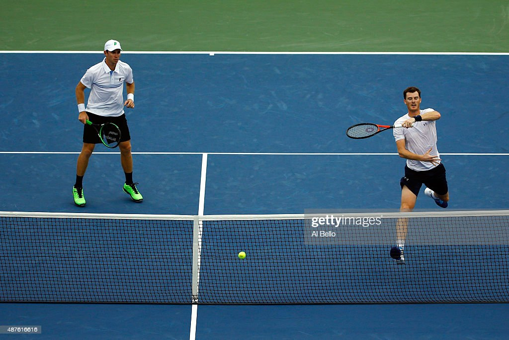 Jamie Murray of Great Britain and John Peers of Australia return a shot against Steve Johnson and Sam Querrey of the United States during their Men's...