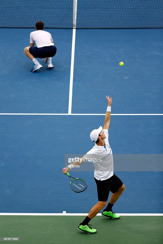 Jamie Murray of Great Britain and John Peers of Australia serve against Steve Johnson and Sam Querrey of the United States during their Men's Doubles...
