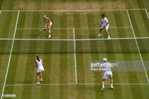 Jamie Murray of Great Britain and Martina Hingis of Switzerland and Ken Skupski of Great Britain and Jocelyn Rae of Great Britain in action during...