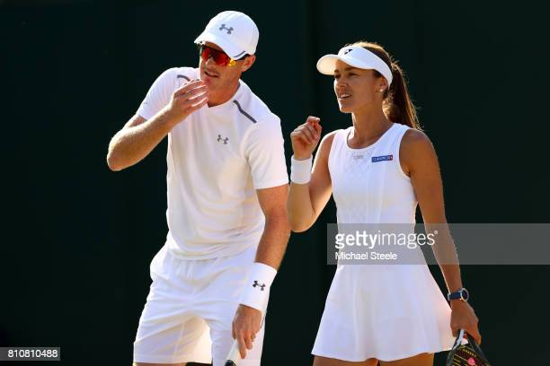 Jamie Murray of Great Britain and Martina Hingis of Switzerland in discussion during the Mixed Doubles second round match against Neal Skupski of...