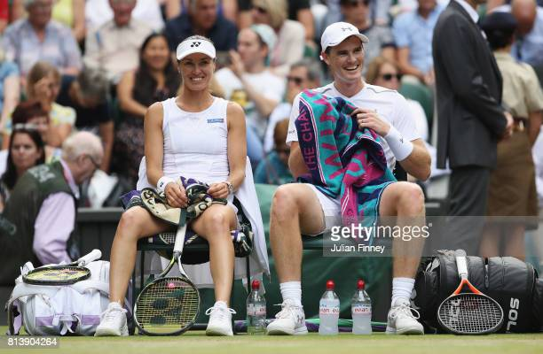 Jamie Murray of Great Britain and Martina Hingis of Switzerland in discussion during the Mixed Doubles quarter final match against Ken Skupski of...
