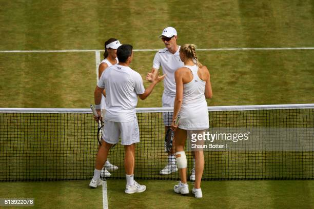 Jamie Murray of Great Britain and Martina Hingis of Switzerland celebrate victory during the Mixed Doubles quarter final match against Ken Skupski of...