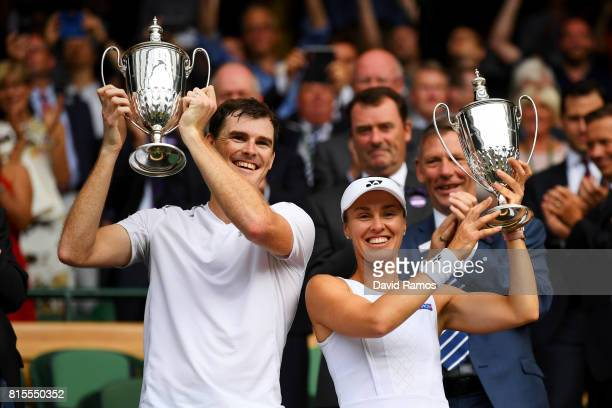 Jamie Murray of Great Britain and Martina Hingis of Switzerland celebrate victory with their trophies after the Mixed Doubles final match against...