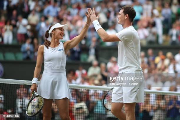 Jamie Murray of Great Britain and Martina Hingis of Switzerland celebrate victory over Henri Kontinen of Finland and Heather Watson of Great Britain...