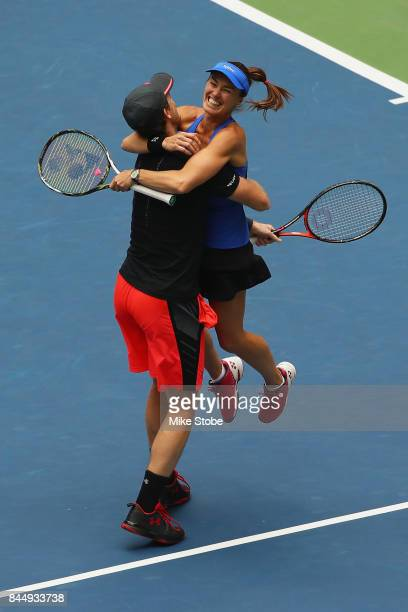 Jamie Murray of Great Britain and Martina Hingis of Switzerland celebrate defeating HaoChing Chan of Taiwan and Michael Venus of New Zealand in their...