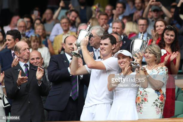 Jamie Murray of Great Britain and Martina Hingis of Switzerland with the winners trophies after victory over Henri Kontinen of Finland and Heather...