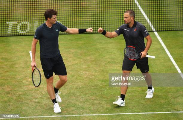 Jamie Murray of Great Britain and partner Bruno Soares of Brazil celebrate during the mens double match against Ryan Harrison of The United States...