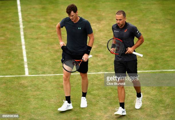 Jamie Murray of Great Britain and partner Bruno Soares of Brazil speak during the mens double match against Ryan Harrison of The United States and...