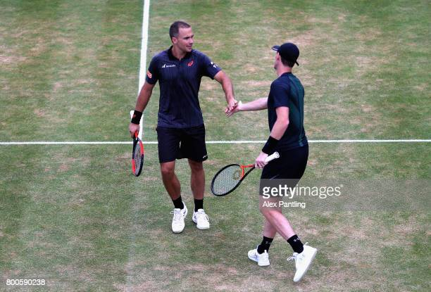 Jamie Murray of Great Britain and partner Bruno Soares of Brazil speak during the mens doubles semifinal match against Marin Cilic of Croatia and...