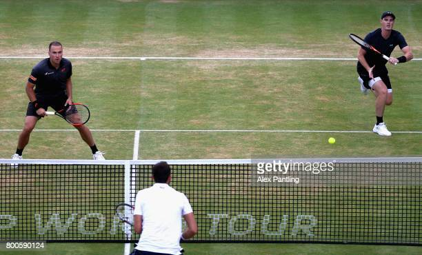 Jamie Murray of Great Britain and partner Bruno Soares of Brazil return the ball during the mens doubles semifinal match against Marin Cilic of...