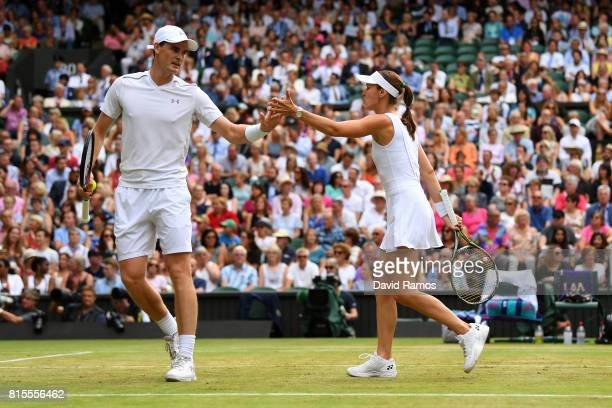 Jamie Murray of Great Britain and partner Martina Hingis of Switzerland celebrate a point during the Mixed Doubles final match against Heather Watson...