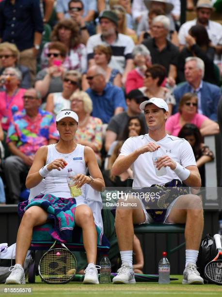 Jamie Murray of Great Britain and partner Martina Hingis of Switzerland in discussion during the Mixed Doubles final match against Heather Watson of...