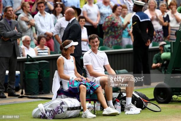 Jamie Murray of Great Britain and partner Martina Hingis of Switzerland look on in victory after the Mixed Doubles final match against Heather Watson...